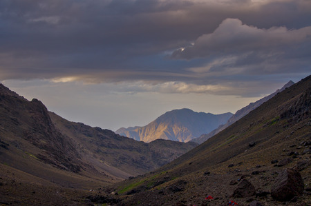 valley below: Tents in valley below the Refuge du Toubkal, in High Atlas mountains in the early evening light