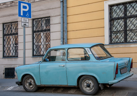 exported: Old East German car, Trabant, sitting on a street in Budapest. It was the most common vehicle in East Germany, and was also exported to countries both inside and outside the former eastern bloc Stock Photo