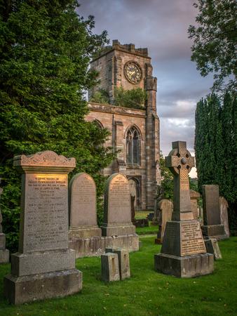 clocktower: Lennoxtown Church Graveyard at sunset