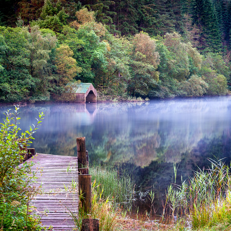 ard: Old wooden Jetty and boathouse on Loch Ard Scottish Highlands