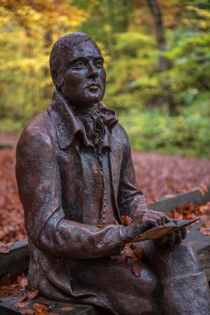 bard: Statue of Scottish Poet Rabbie Burns at the Birks of Aberfeldy