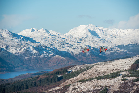 loch lomond: Loch Lomond, Scotland. 14 January 2016. The Royal Navys Sea King Rescue helicopters which are based at HMS Gannet in Prestwick, made a final farewell flight today. The flight took place over many areas of western Scotland where their rescues took place an Stock Photo