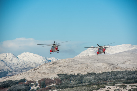 hms: Loch Lomond, Scotland. 14 January 2016. The Royal Navys Sea King Rescue helicopters which are based at HMS Gannet in Prestwick, made a final farewell flight today. The flight took place over many areas of western Scotland where their rescues took place an Stock Photo