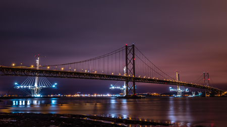 forth: The old and new Forth Road bridges from Queensferry at night Stock Photo