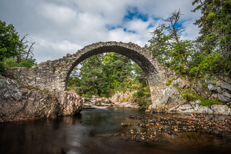 old packhorse bridge: Cartridge, the old military bridge over the river Dulnain in the highlands of Scotland