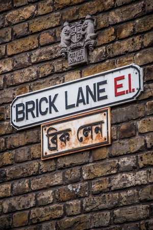 multilingual: Multilingual Street signs in Brick Lane, London Stock Photo