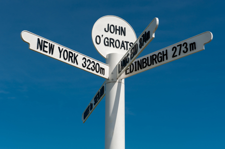 milepost: The milepost sign at John O Groats in Scotland on the most north eastern tip of the UK Stock Photo