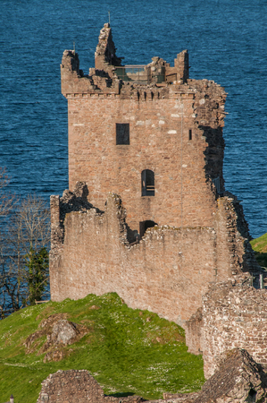 Urquhart Castle sits beside Loch Ness in the Highlands of Scotland overlooking the Urquhart Bay on the Loch. Stock Photo