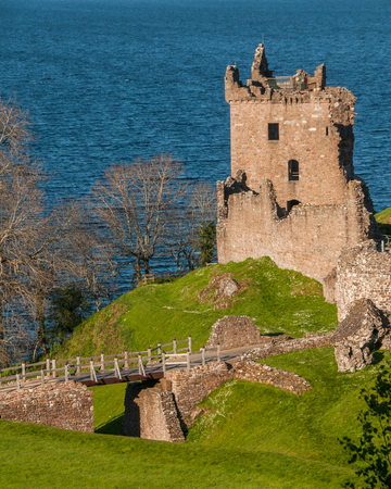Urquhart Castle sits beside Loch Ness in the Highlands of Scotland overlooking the Urquhart Bay on the Loch. Editorial
