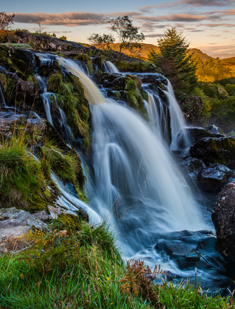 Sunrise at the Loup of Fintry waterfall north of Glasgow Scotland