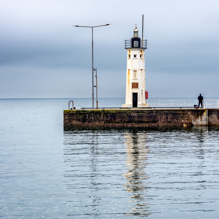 The octagonal Lighthouse at Anstruther was built  in 1880 and was dedicated to Dr Thomas Chalmers, a local scientist . It marks the end of the breakwater at the harbour entrance and stands 9 metres high. Stock fotó