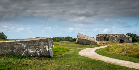 Remains of the German concrete bunkers that were part of the Atlantic Wall in 1944 at Ponte du Hoc in Normandy Editorial