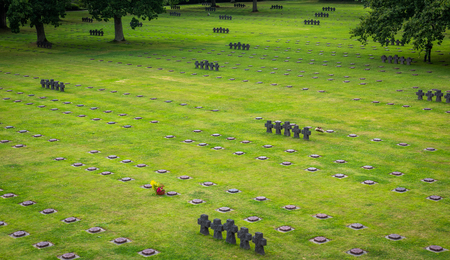 La Cambe is a German war grave cemetery, located close to Bayeux, France. It is reported to contain in excess of 21,000 bodies of German military from World War II. The crosses here are made from grey schist and do not mark individuals graves. Editorial