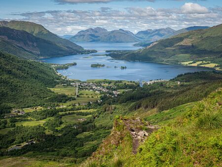 Looking west from the path to the summit of Sgorr na Ciche or the Pap of Glencoe. A prominient summit above the village of Glencoe in the Scottish Highlands Фото со стока