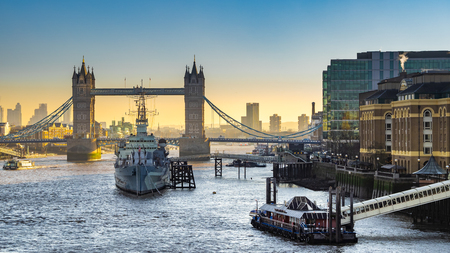 Sunrise at Tower Bridge & HMS Belfast. Tower Bridge is a combined bascule and suspension bridge in London, England, over the River Thames