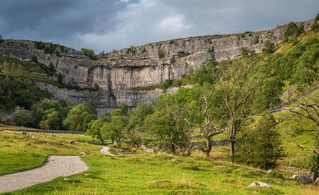 Malham Cove is a limestone formation in Yorkshire Dales National Park, England. It was formed by a waterfall carrying meltwater from glaciers at the end of the last Ice Age more than 12,000 years ago