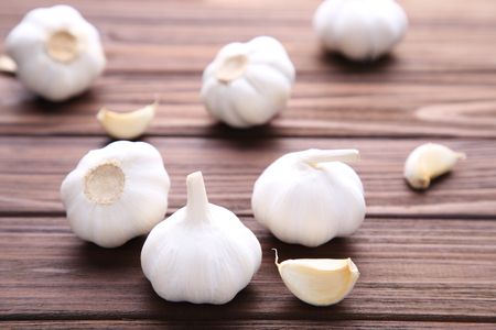 Fresh garlic on a brown background. Garlic on brown wooden table