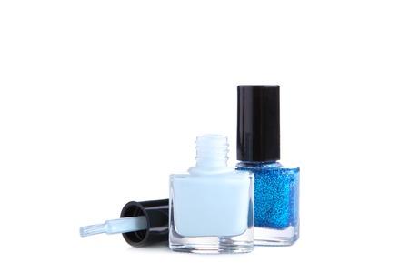 Blue nail polishes bottle isolated on white background, close up