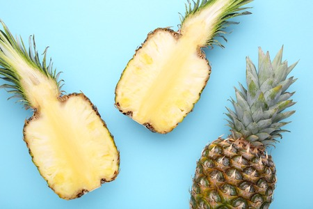 Ripe pineapples on a colorful background