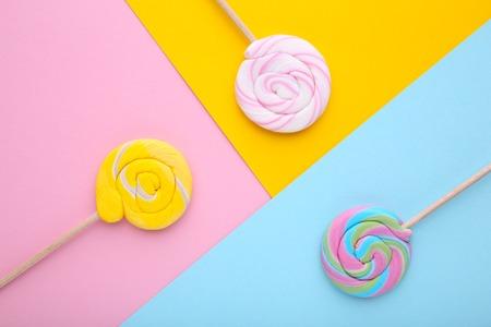 Many lollipops on colorful background. Studio shot