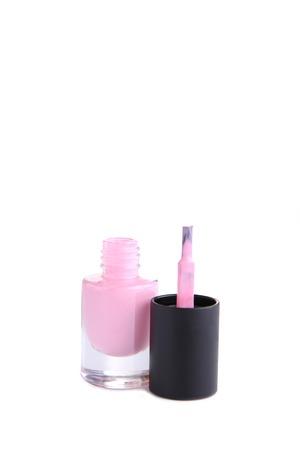 Pink nail polish bottle isolated on white background, close up