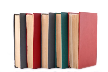 Stack of vintage books isolated on white background