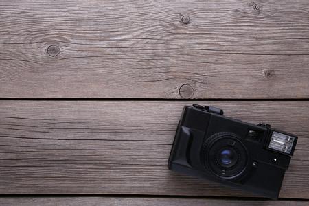 Vintage camera on grey wooden background. Old photo camera on grey wooden background