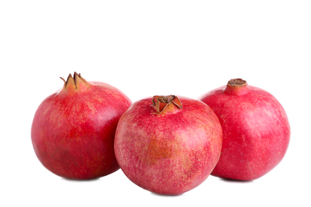 Ripe pomegranates isolated on a white background, cut out