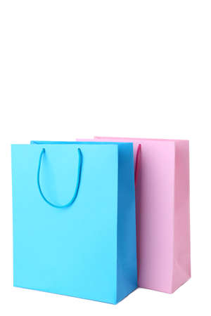 Colorful paper shopping bags isolated on white, cut out