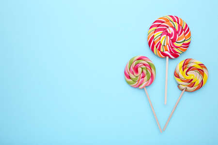 Sweet colorful lollipops on blue background Stock Photo