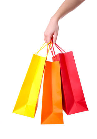 Hand holding colorful paper bags isolated on white background shopping concept