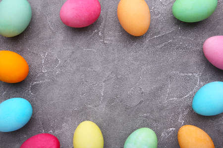 Colorful easter eggs on gray cement background