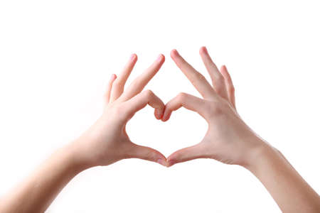 Female hands in heart shape isolated on a white background