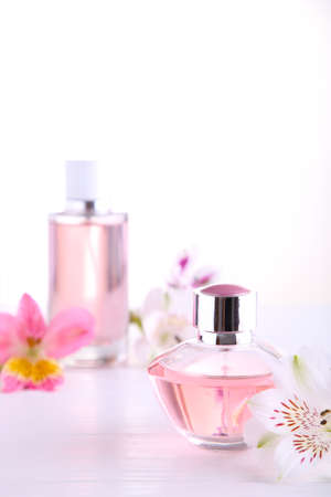 Many perfume bottles on a white background, top view