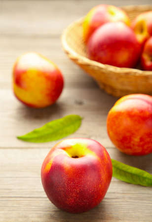 Nectarines in a basket on gray background with copy space. Top view Reklamní fotografie
