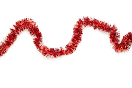 Christmas red tinsel isolated on white background. Top view.