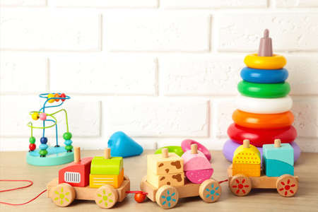 Children's toys collection on a light background. Top view