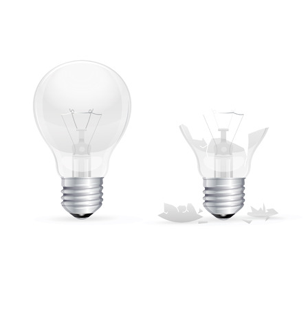 Whole and Broken Light Bulb on a White Background.