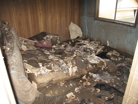 Flooded Bedroom in a Destroyed Home