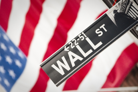 nyse: Wall Street Sign with US Flag Behind Stock Photo
