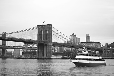 forground: Brooklyn Bridge and a boat in forground Stock Photo