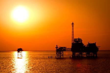 Oil rig in the sunset photo