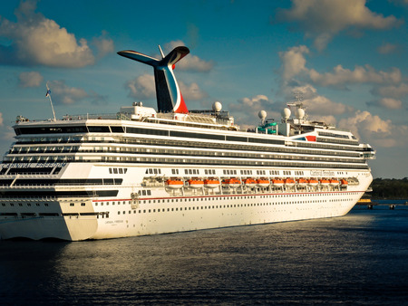 cayman: Carnival Freedom anchored  in the port of Grand Cayman