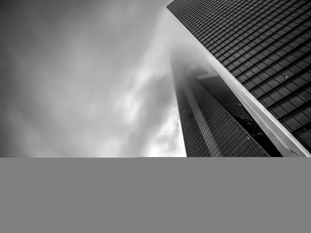 freedom tower: New York, USA - June 15, 2015: Black and white image of the One World Trade Center also named The Freedom Tower coverd by fog