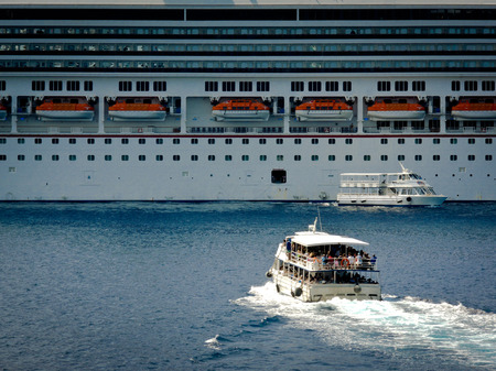 best travel destinations: Tender boat bring back the passengers to the cruise ship