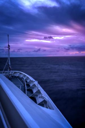 sailling: Cruise ship sailling into the horizon Stock Photo