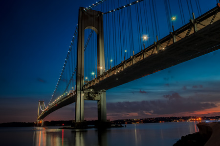 The bridge connecting Brooklyn to Staten Island named Verrazano bridge seen at dusk