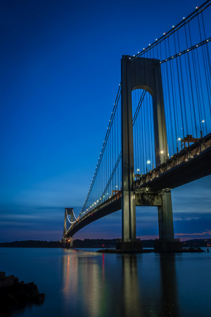 The bridge connecting Brooklyn to Staten Island named Verrazano bridge seen at dusk