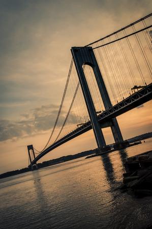 bridging: The bridge connecting Brooklyn to Staten Island named Verrazano bridge seen at dusk