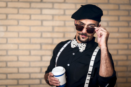 Pretentoius hipster giving a over the glasses look to the camera Stockfoto